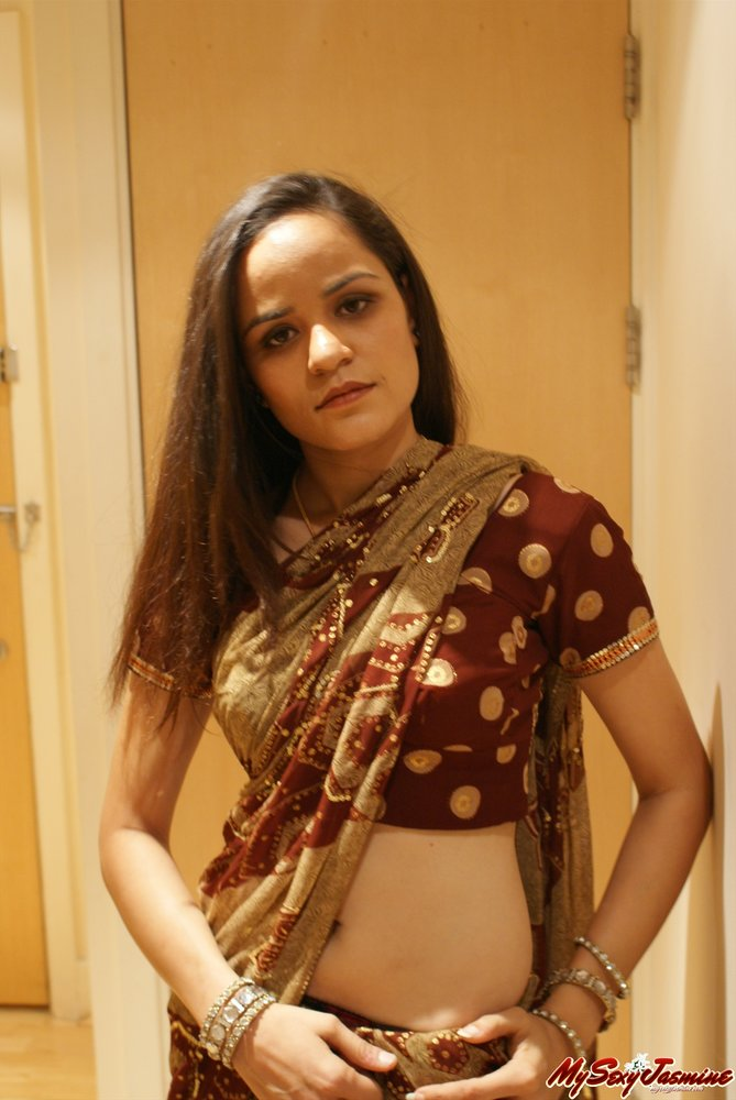Beautiful indian babe undressing for love