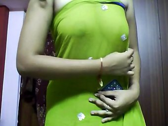 Hot Indian Aunty In Green Sari Stripping Naked