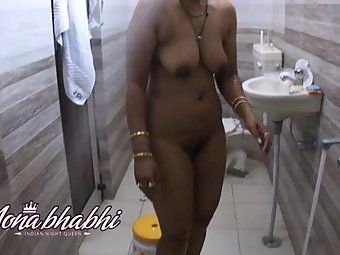 Mona taking shower in hotel bathroom